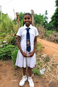 Maheshika Dilhani, proud in her school uniform.