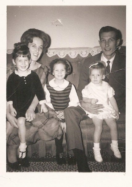 A cherished photo of the Canadays. Patricia is in the striped dress. Juli is the smiling toddler.