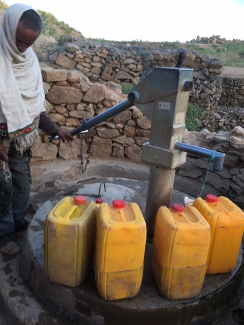 Collecting fresh water last month in Ethiopia. The rectangle under the spout is a sensor that reports back whether the pump is working.